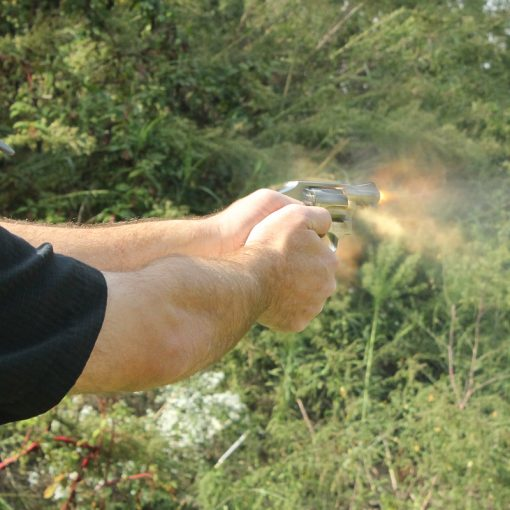 David Maglio shooting a revolver with fire